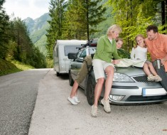 bigstock-Family-with-camping-car-on-the-16369220