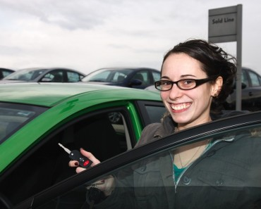 bigstock-Happy-Young-Woman-Buying-a-Car-45756397