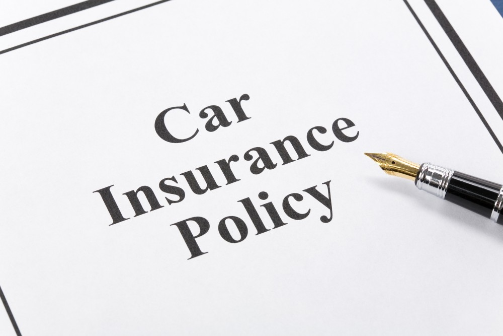 bigstock-Car-Insurance-Policy-3544650