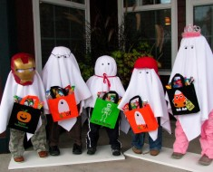 bigstock-Five-Trick-or-Treat-Ghosts-on--23410340