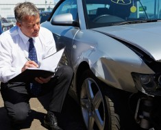 bigstock-Loss-Adjuster-Inspecting-Car-I-47469430