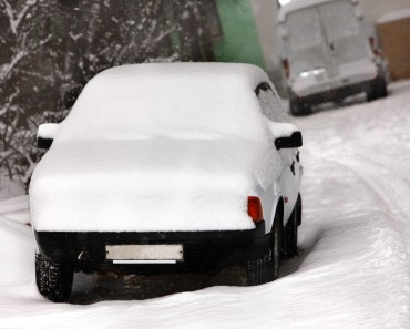 bigstock-Car-after-deep-snowfall-in-cit-21190670