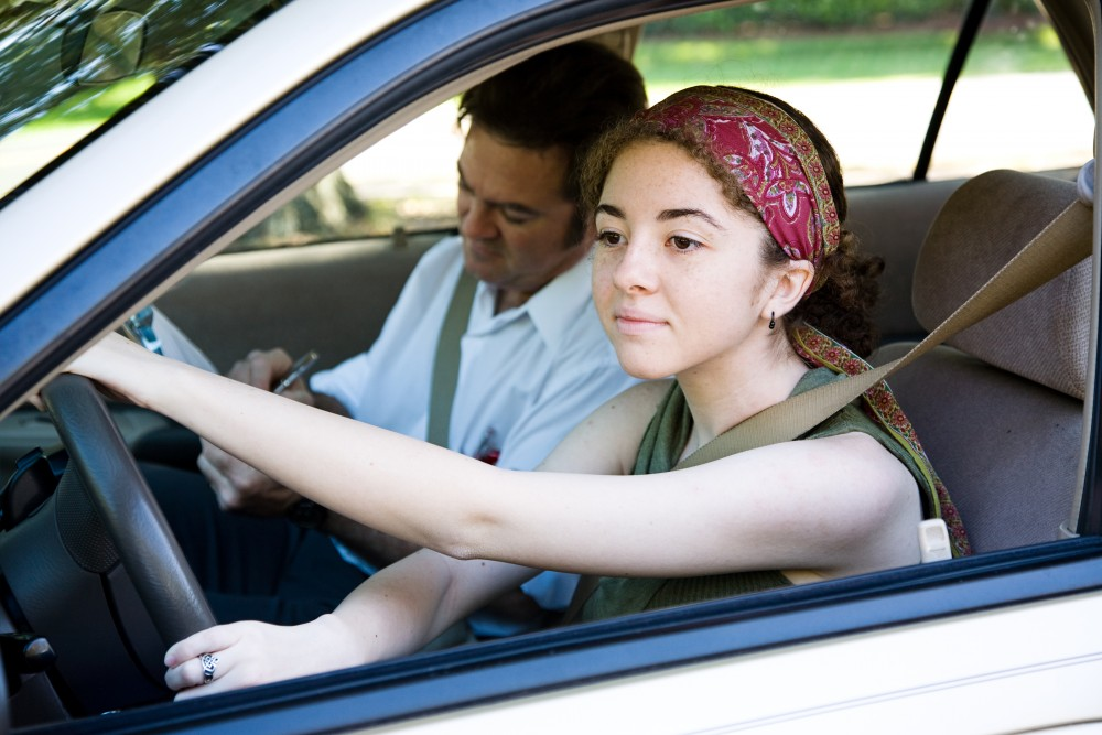 bigstock-Teen-driver-taking-driving-les-11989307